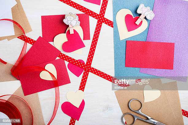 making valentines day card, top view - hearts playing card stock photos and pictures