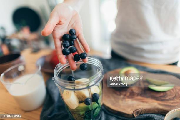making vegan smoothie for a healthy diet - refreshment stock pictures, royalty-free photos & images