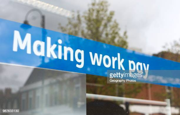 Making Work Pay banner in window of Job Centre Plus office Department for Work and Pensions Devizes Wiltshire England UK
