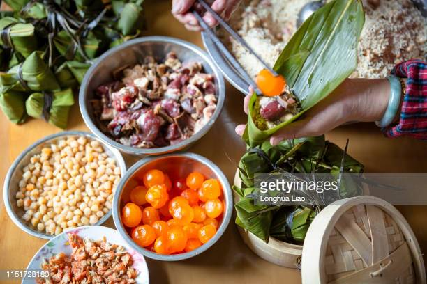 making zongzi - dragon boat festival stock pictures, royalty-free photos & images