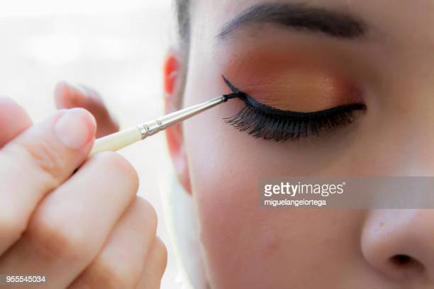 making-up the eyes - stage make up stock photos and pictures