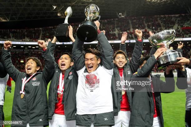 Makino Tomoaki of Urawa Red Diamonds leads the players of Urawa Red Diamonds celebrate the champion after the 98th Emperor's Cup Final between Urawa...