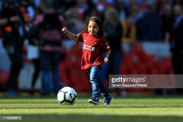 Makka Mohamed Salah daughter of Mohamed Salah of Liverpool dribbles the ball on the pitch after the Premier League match between Liverpool and...