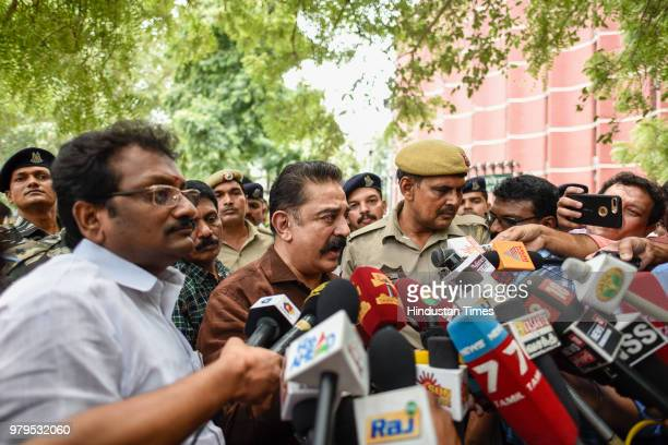 Makkal Needhi Maiam President Kamal Haasan with party executives speaks to media personnel after meeting with Election Commission officials to...