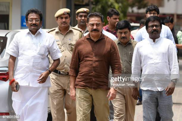 Makkal Needhi Maiam President Kamal Haasan with senior party members after a meeting with Election Commission officials to formally register his...