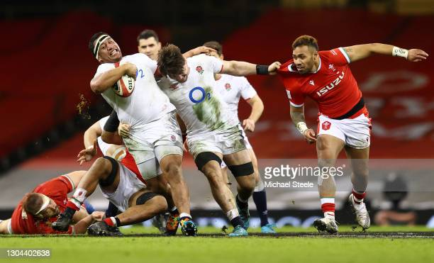 Mako Vunipola and Tom Curry of England drive forward as Willis Halaholo of Wales looks to challenge during the Guinness Six Nations match between...