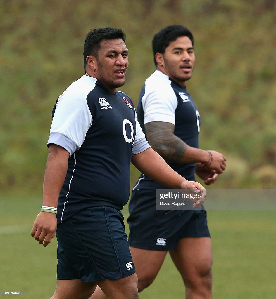 Mako Vunipola (L) looks on with team mate Manu Tuilagi during the England training session held at Pennyhill Park on February 26, 2013 in Bagshot, England.