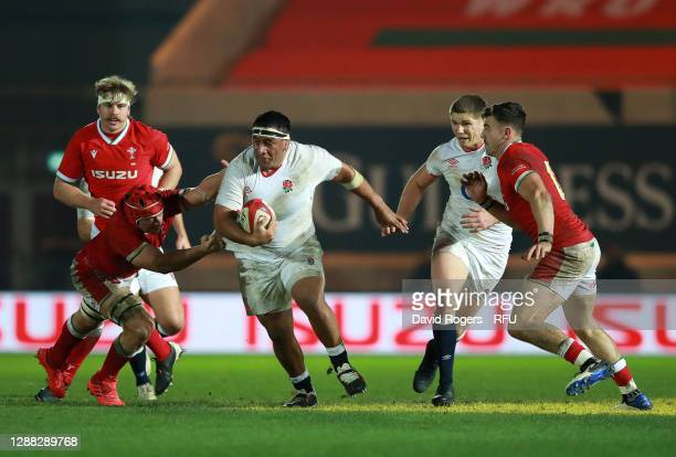 Mako Vunipola of England gets way from James Botham of Wales during the Autumn Nations Cup match between Wales and England at Parc y Scarlets on...