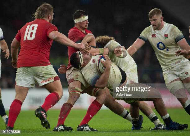Mako Vunipola of England is tackled by Aaron Shingler of Wales during the NatWest Six Nations match between England and Wales at Twickenham Stadium...