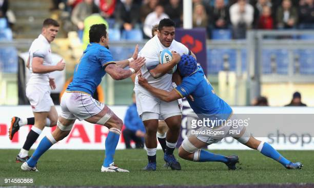 Mako Vunipola of England is tackled by Dean Budd and Alessandro Zanni during the NatWest Six Nations match between Italy and England at Stadio...