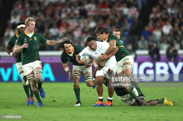 Mako Vunipola of England is tackled by Eben Etzebeth of South Africa during the Rugby World Cup 2019 Final between England and South Africa at...