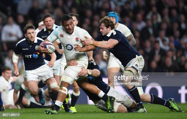 Mako Vunipola of England is tackled by Richie Gray of Scotland during the RBS Six Nations match between England and Scotland at Twickenham Stadium on...