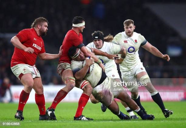 Mako Vunipola of England is tackled during the NatWest Six Nations round two match between England and Wales at Twickenham Stadium on February 10...
