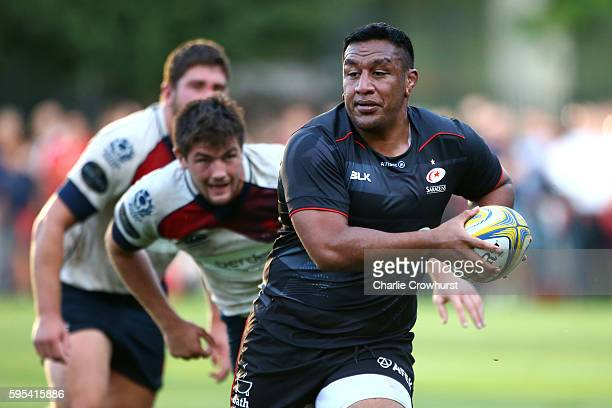 Mako Vunipola of Saracens looks to break through the London Scottish defence during the pre season friendly match between Saracens and London...