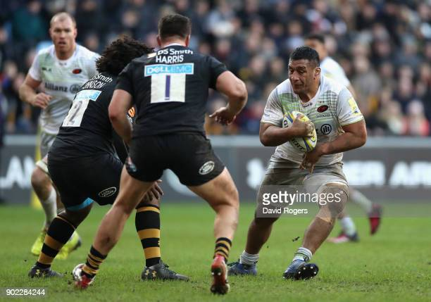 Mako Vunipola of Saracens runs with the ball during the Aviva Premiership match between Wasps and Saracens at The Ricoh Arena on January 7 2018 in...
