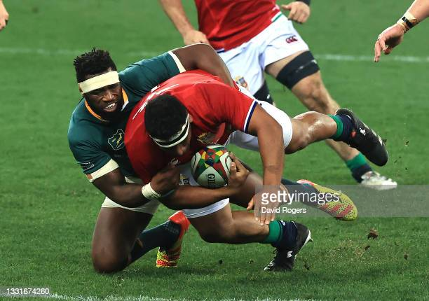 Mako Vunipola of the Lions is tackled by Siya Kolisi during the 2nd test match between South Africa Springboks and the British & Irish Lions at Cape...