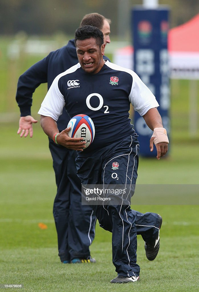 Mako Vunipola runs with the ball during the England training session held at St Georges Park on October 29, 2012 in Burton-upon-Trent, England.