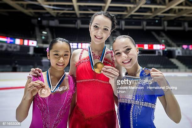 Mako Yamashita of Japan Polina Tsurskaya and Elizaveta Nugumanova of Russia and pose for a photo during the Junior Ladies Medal Ceremony on day two...