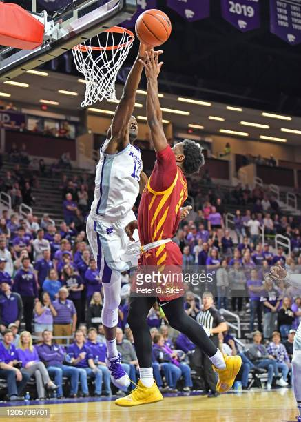Makol Mawien of the Kansas State Wildcats blocks the shot attempt of Tre Jackson of the Iowa State Cyclones during the first half at Bramlage...