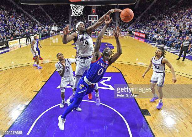 Makol Mawien of the Kansas State Wildcats blocks the shot of Marcus Garrett of the Kansas Jayhawks during the second half at Bramlage Coliseum on...