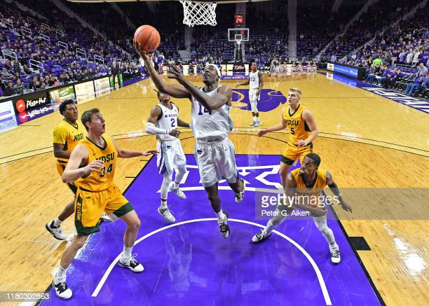 Makol Mawien of the Kansas State Wildcats drives in for a basket against Rocky Kreuser of the North Dakota State Bison during the first half on...