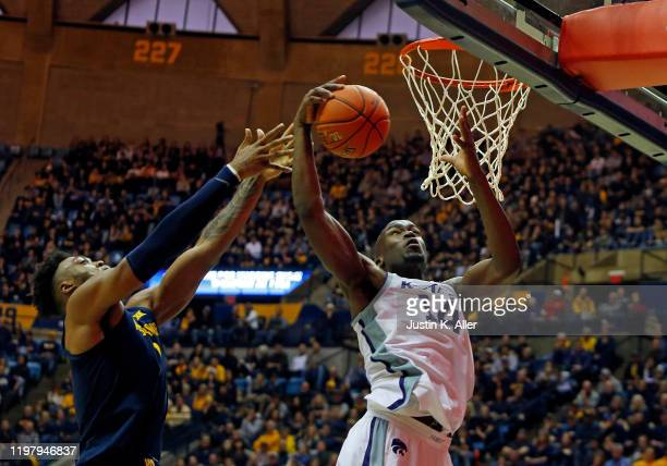 Makol Mawien of the Kansas State Wildcats pulls down a rebound against the West Virginia Mountaineers at the WVU Coliseum on February 1 2020 in...