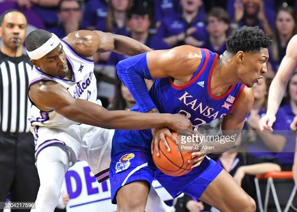 Makol Mawien of the Kansas State Wildcats reaches in for the ball against David McCormack of the Kansas Jayhawks during the second half at Bramlage...