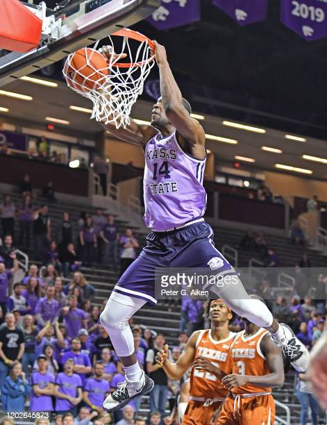 Makol Mawien of the Kansas State Wildcats scores with a dunk during the second half against the Texas Longhorns at Bramlage Coliseum on February 22,...