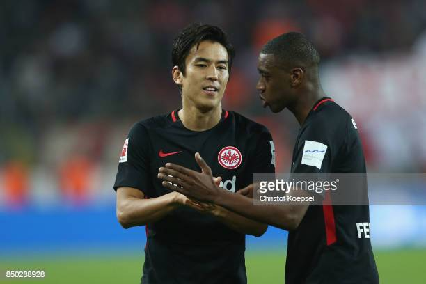 Makoto Hasebe and Gelson Fernandes of Frankfurt celebrate after the Bundesliga match between 1 FC Koeln and Eintracht Frankfurt at...