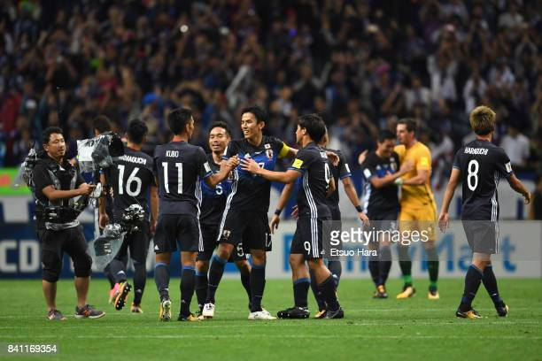 Makoto Hasebe and Japan players celebrate their 20 victory and qualified for the FIFA World Cup Russia after the FIFA World Cup Qualifier match...