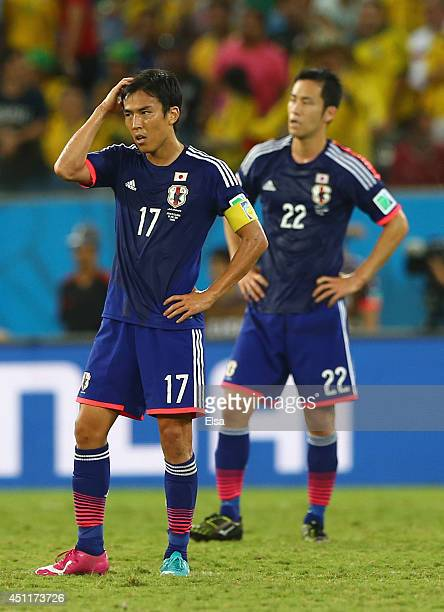Makoto Hasebe and Maya Yoshida of Japan look dejected during the 2014 FIFA World Cup Brazil Group C match between Japan and Colombia at Arena...