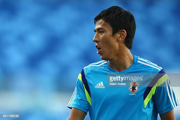 Makoto Hasebe encourages his team members during a drill at a Japan training session at Arena Pantanal on June 23 2014 in Cuiaba Mato Grosso