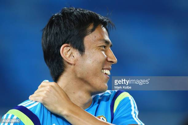 Makoto Hasebe laughs during a Japan training session at the Dunas Arena in Natal on June 18 2014 in Natal Rio Grande do Norte