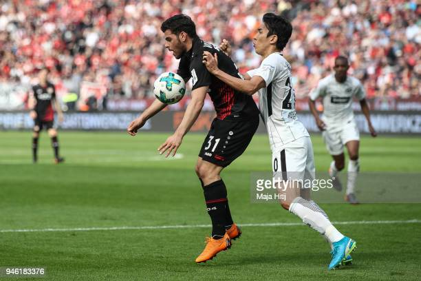 Makoto Hasebe of Eintracht Frankfurt and Kevin Volland of Bayer Leverkusen battle for the ball the Bundesliga match between Bayer 04 Leverkusen and...