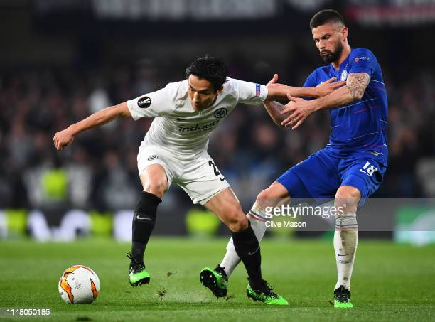 Makoto Hasebe of Eintracht Frankfurt battles for possession with Olivier Giroud of Chelsea during the UEFA Europa League Semi Final Second Leg match...