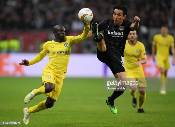 Makoto Hasebe of Eintracht Frankfurt jumps for the ball with N'golo Kante of Chelsea during the UEFA Europa League Semi Final First Leg match between...