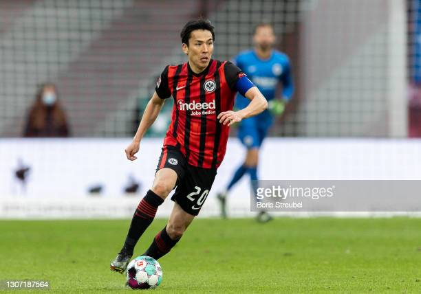 Makoto Hasebe of Eintracht Frankfurt runs with the ball during the Bundesliga match between RB Leipzig and Eintracht Frankfurt at Red Bull Arena on...