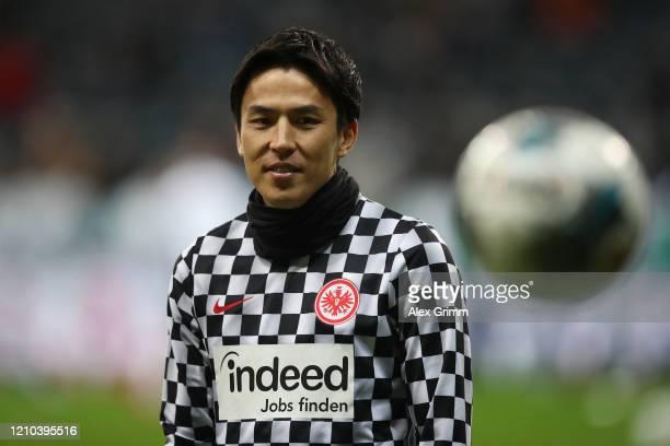 Makoto Hasebe of Eintracht Frankfurt warms up prior to the DFB Cup quarterfinal match between Eintracht Frankfurt and Werder Bremen at Commerzbank...