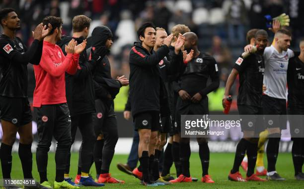 Makoto Hasebe of Frankfurt and his teammates celebrate with the fans after the Bundesliga match between Eintracht Frankfurt and 1 FC Nuernberg at...