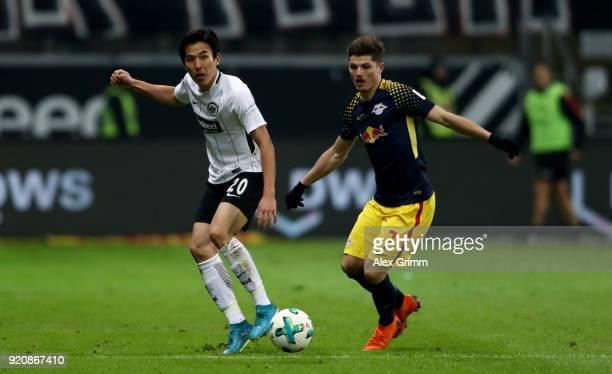 Makoto Hasebe of Frankfurt and Marcel Sabitzer of Leipzig battle for the ball during the Bundesliga match between Eintracht Frankfurt and RB Leipzig...