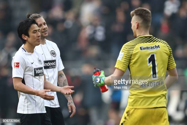 Makoto Hasebe of Frankfurt celebrates with Marco Russ of Frankfurt and goalkeeper Lukas Hradecky of Frankfurt after the Bundesliga match between...