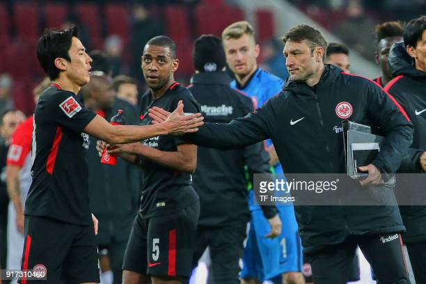 Makoto Hasebe of Frankfurt Gelson Fernandes of Frankfurt and Assistant coach Robert Kovac of Frankfurt look dejected after the Bundesliga match...