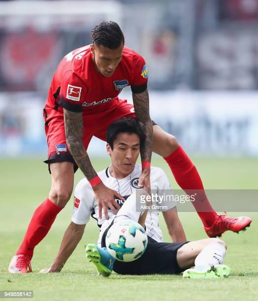 Makoto Hasebe of Frankfurt is challenged by Davie Selke of Berlin during the Bundesliga match between Eintracht Frankfurt and Hertha BSC at...