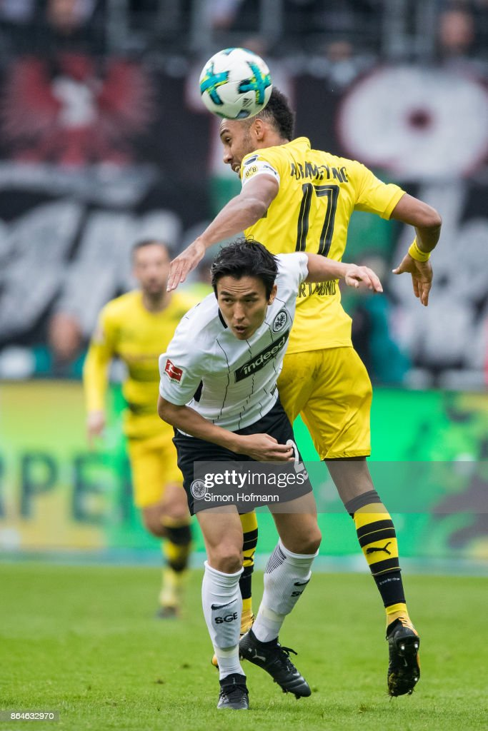 Makoto Hasebe of Frankfurt is tackled by Pierre-Emerick Aubameyang of Dortmund during the Bundesliga match between Eintracht Frankfurt and Borussia Dortmund at Commerzbank-Arena on October 21, 2017 in Frankfurt am Main, Germany.