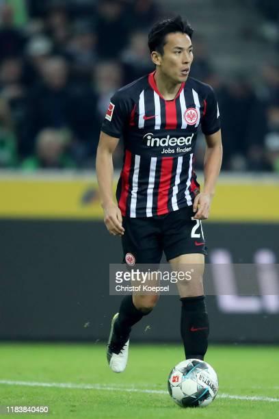 Makoto Hasebe of Frankfurt runs with the ball during the Bundesliga match between Borussia Moenchengladbach and Eintracht Frankfurt at Borussia-Park...