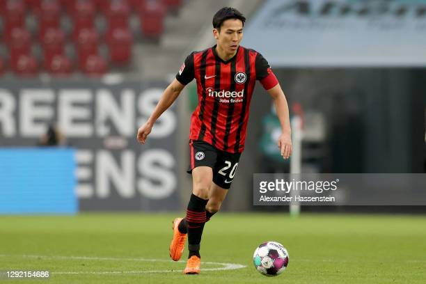Makoto Hasebe of Frankfurt runs with the ball during the Bundesliga match between FC Augsburg and Eintracht Frankfurt at WWK-Arena on December 19,...