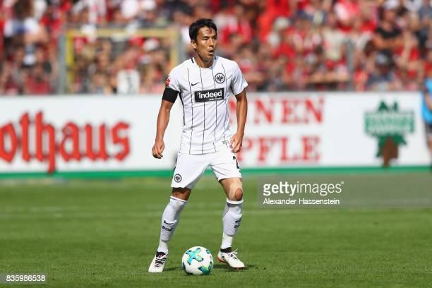 Makoto Hasebe of Frankfurt runs with the ball during the Bundesliga match between SportClub Freiburg and Eintracht Frankfurt at SchwarzwaldStadion on...