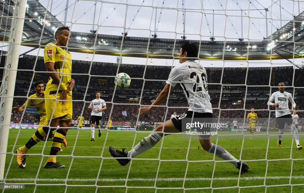 Makoto Hasebe of Frankfurt saves the ball on the line during the Bundesliga match between Eintracht Frankfurt and Borussia Dortmund at Commerzbank-Arena on October 21, 2017 in Frankfurt am Main, Germany.