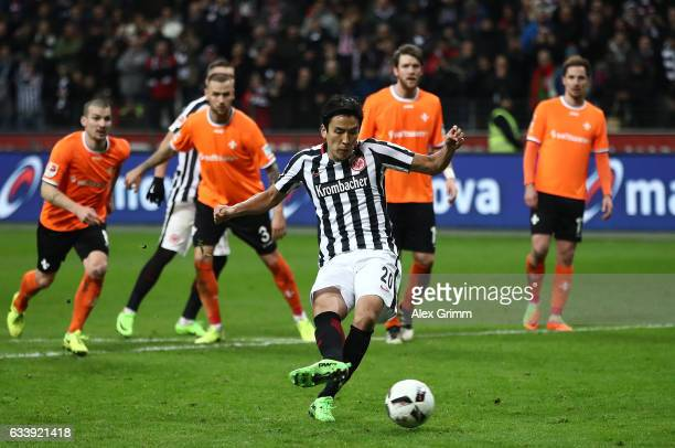 Makoto Hasebe of Frankfurt scores the penalty during the Bundesliga match between Eintracht Frankfurt and SV Darmstadt 98 at CommerzbankArena on...