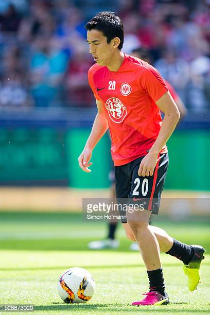 Makoto Hasebe of Frankfurt warms up prior to the Bundesliga match between Eintracht Frankfurt and Borussia Dortmund at CommerzbankArena on May 07...